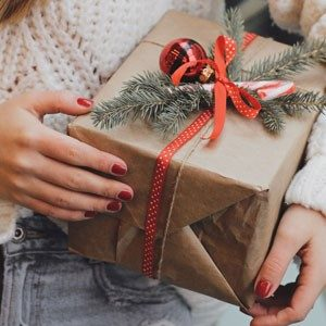 holding a wrapped gift